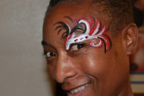 Red, white and black swirls painted over an eye.